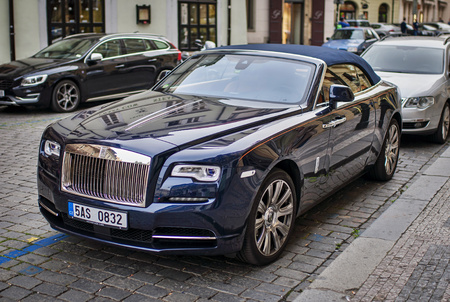 Prague, The Czech Republic, 28.9.2017: Blue Rolls-royce ghost car parking in the street. Editorial