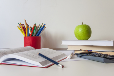 School supplies on white background. School tools, whiteboard, pencils, books and free space for your text.