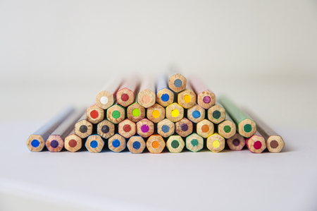 Colored pencils on isolated background. Closeup of colored pencils with a lot of colors. Rear view Stock Photo
