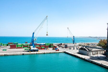 Bari, Italy, 24.4.2019: Big cargo port with cranes moving containers. Cargo dock in Italy.