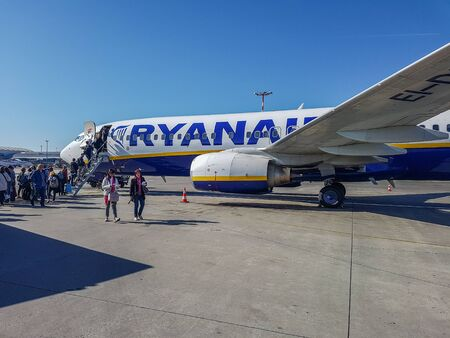 Prague, The Czech Republic, 22.4.2019: passengers boarding into plane. Low cost company Ryanair. Ryanair plane at the airport in Prague. 報道画像