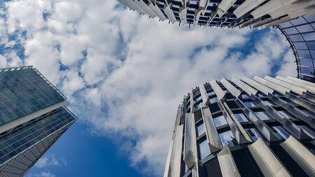 Closeup of skycraper business center. Glass business center with blue sky. windows of modern office centre. 写真素材