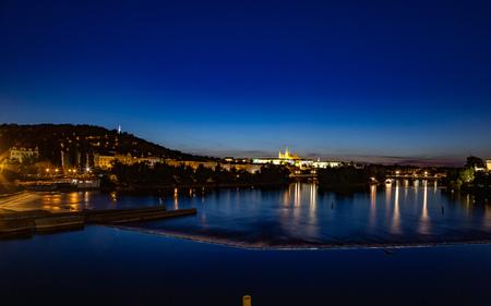 Panorama of night Prague with Prague Castle and river Vltava. Night cityscape 報道画像