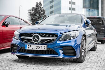 Prague, The Czech Republic, 1.9.2019: Luxury Mercedes Benz C-class coupe in blue, parked in front of