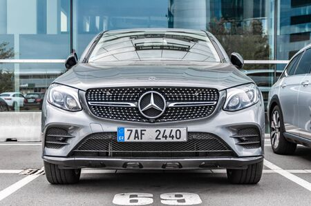 Prague, The Czech Republic, 1.9.2019: Luxury Mercedes Benz GLA  parked in front of car dealership Mercedes Benz. Closeup of car. front view.