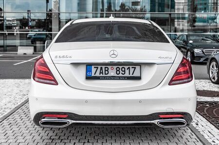 prague, The Czech Republic, 1.9.2019: Luxury white Mercedes Benz S-Class 350d 4matic parked in front of car dealership Mercedes Benz. Rear view of car. Éditoriale