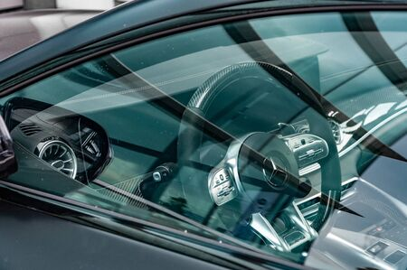 prague, The Czech Republic, 1.9.2019: Interior of Mercedes Benz. Luxury leather interior of Mercedes Benz. Closeup view to steering wheel