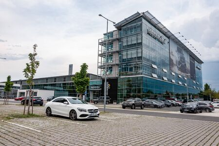 Prague, The Czech Republic, 1.9.2019: Luxury Mercedes Benz car dealership in Prague with parked cars in front of car store.