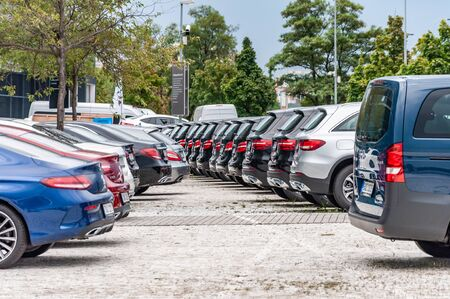 Prague, The Czech Republic, 1.9.2019: Luxury Mercedes Benz cars parked in row in front of car dealership Mercedes Benz. Rear view to row of parked cars. Éditoriale