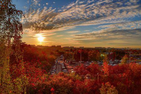 autumn nature. autumn landscape with sunset above the city.