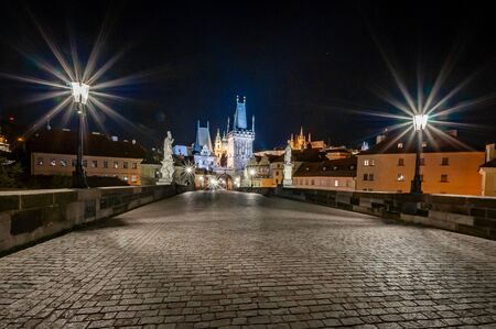 Empty Charles Bridge in Prague at night. Empty Prague during pandemic covid-19. No people. 写真素材