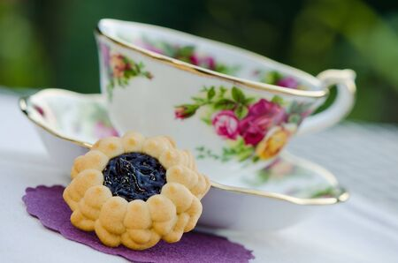 Colorful antique teacup with healthy green tea and healthy biscuit Stock Photo