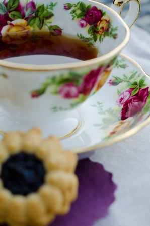 Colorful antique teacup with healthy green tea and healthy biscuit photo