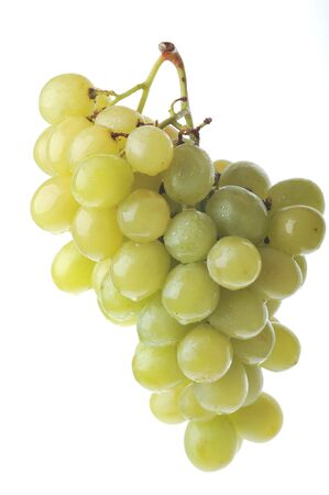 fresh and tasty green grapes isolated on white background