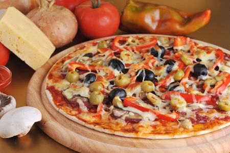 fresh baked pizza with pepperoni olives and peppers Stock Photo - 5694664