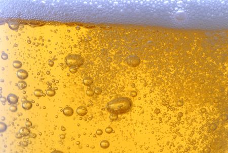 beer with bubbles close up photo