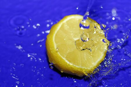 water drops on sliced lemon close up photo