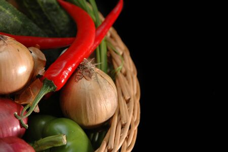 vegetables in the basket on black background photo