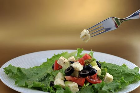 salat with feta cheese and fresh vegetables  close up photo