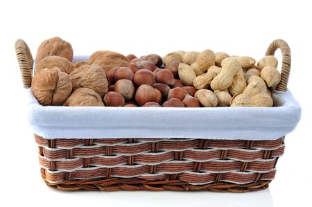 different nuts in basket isolated on white photo