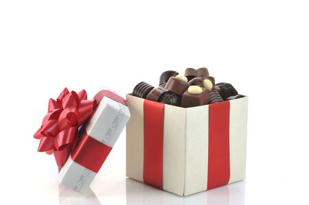 different chocolate in gift box photo