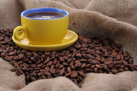 coffee beans and yellow cup  photo