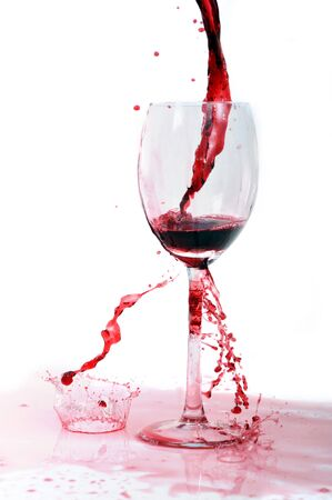 red wine flowing in transparent glass photo