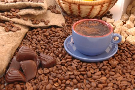 coffee beans, sugar and cup with coffee Stock Photo - 5704946