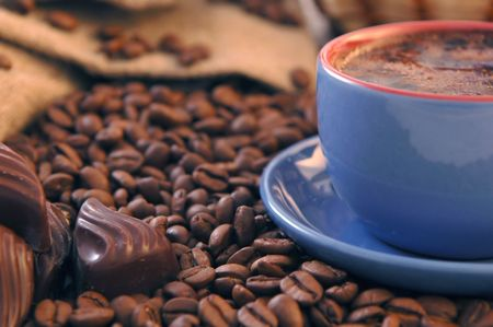 coffee beans and cup with coffee Stock Photo - 5704526