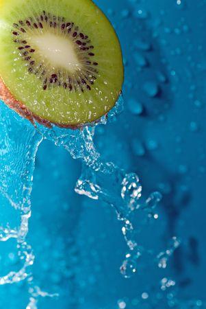 water drops on slice of kiwi photo