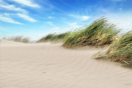desert sun: White clouds over dunes
