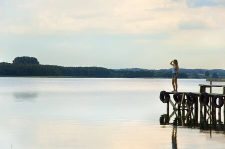 girl waiting on the lake bridge Stock Photo - 6510600