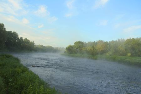 early morning on bank of river photo