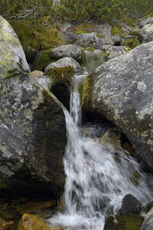 waterfall on the mountain river photo