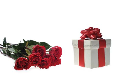 champers: beautiful red roses and present with ribbon Stock Photo