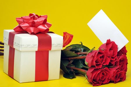 beautiful red roses ,present with ribbon and name card