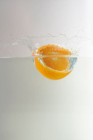 orange enter into water with spalsh photo