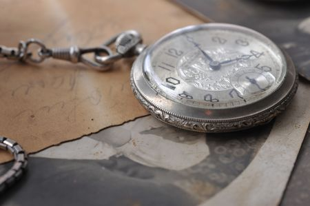 very old watch on the grungde post card and photo photo