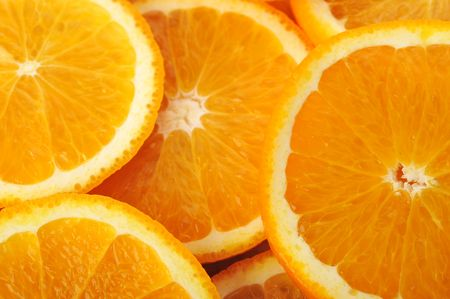 valencia orange: background made of sliced juicy oranges Stock Photo