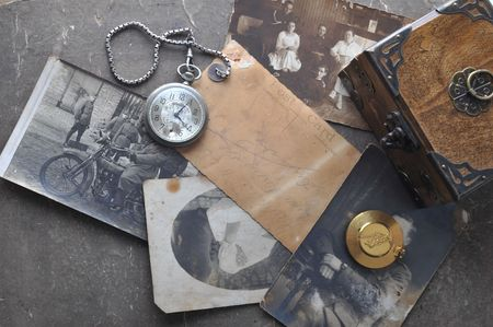 color photographs: very old watch on the grungde post card and photo