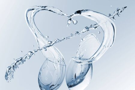 beautiful  water splash as heart with arrow photo
