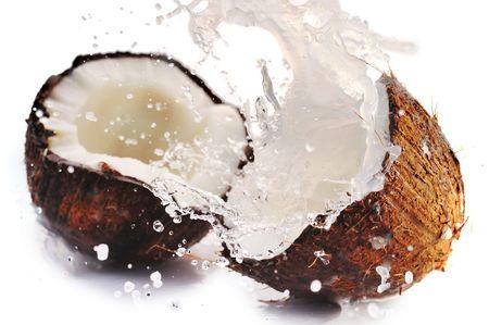 cracked coconut with big splash Stock Photo