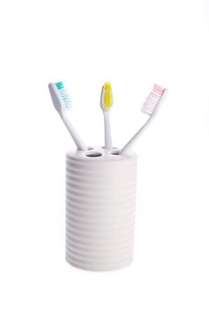 color toothbrush isolated on white background photo