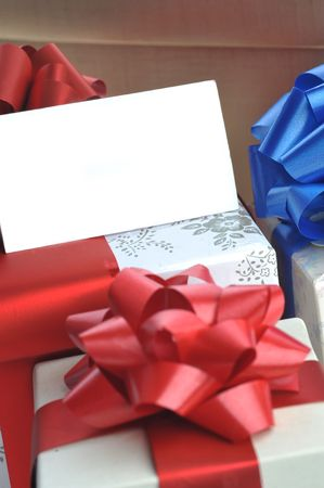 gift boxes with name card close up photo