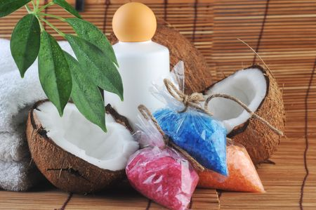 leaves, coconut, towel and salt for  bath on  straw napkin photo