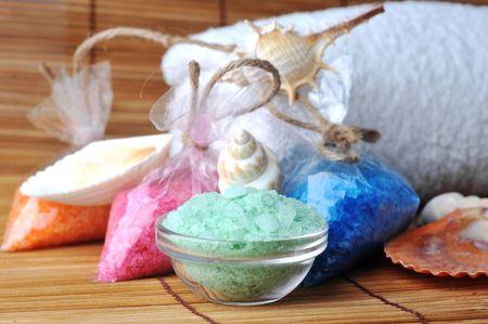 sea cockleshells and salt for  bath on straw napkin photo