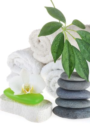 towel, green soap and stones on white photo