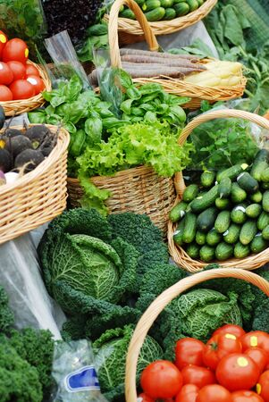 many different ecological vegetables on market table photo