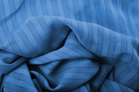 blue fabric close up as background photo