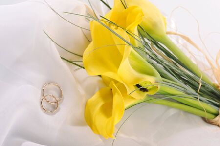 yellow flowers and wedding rings  photo